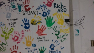 Here is the hand prints of all the uncles. The one on the right that is still wet is mine.
